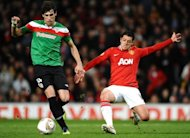 Athletic Bilbao&#39;s Spanish midfielder Javier Martnez (L) vies with Manchester United&#39;s Mexican forward Javier Hernndez during a UEFA Europa League match between Manchester United and Athletico Bilbao at Old Trafford in March 2012. Bayern Munich chief Karl-Heinz Rummenigge hopes to sign Martinez from Athletic Bilbao before August&#39;s transfer window closes