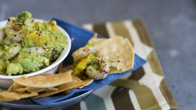 In this image taken on January 7, 2013, shrimp and mango guacamole is shown served in a bowl in Concord, N.H. (AP Photo/Matthew Mead)