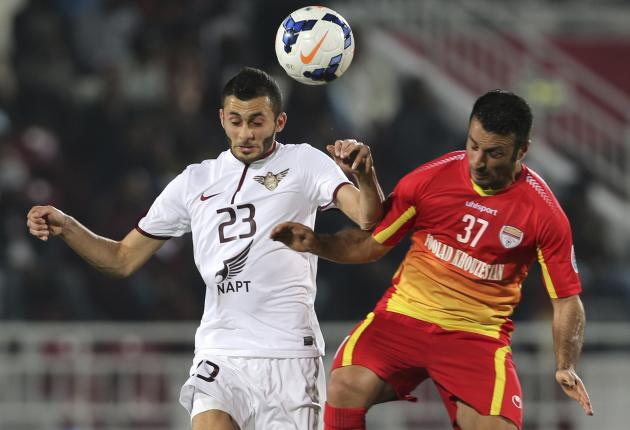 Abdulraaof of El Jaish fights for the ball with Rezaei of Foolad during their AFC Champions League soccer match in Doha