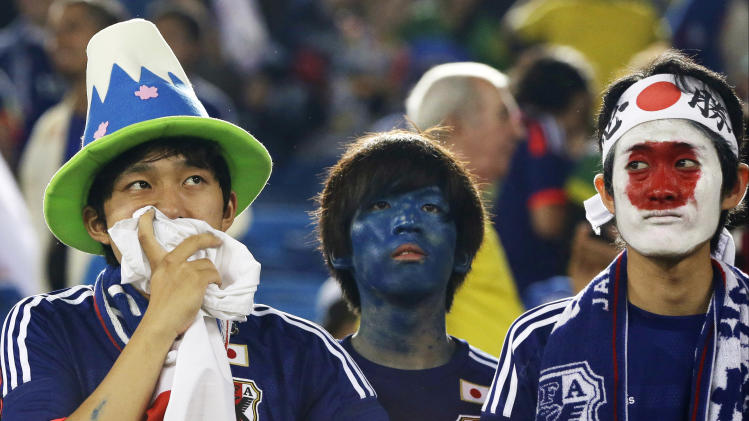 Japanese fans watch their national team after their 0-0 tie with Greece during the group C World Cup soccer match between Japan and Greece at the Arena das Dunas in Natal, Brazil, Thursday, June 19, 2014. (AP Photo/Shuji Kajiyama)