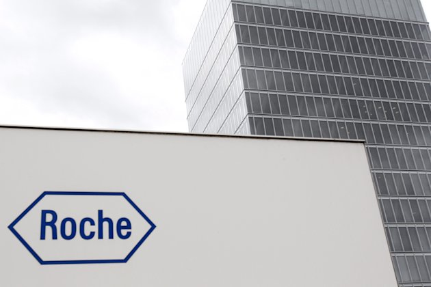 FILE - In this June 6, 2011 file picture, the logo of Swiss drugmaker Roche is photographed in Rotkreuz, Switzerland. The European Medicines Agency has started an infringement procedure against pharmaceutical giant Roche for allegedly failing to properly report side effects in patients in the U.S. (AP Photo/Keystone/Urs Flueeler, File)