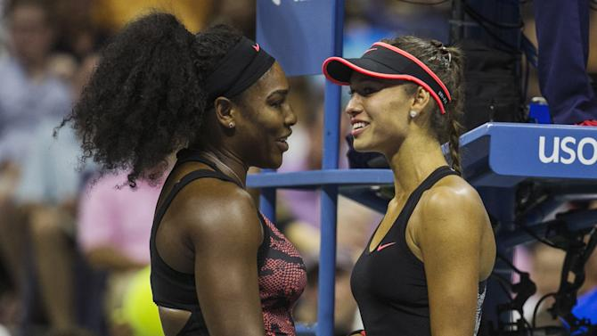 Williams of the U.S. talks to Diatchenko of Russia after Diatchenko retired from their match after an injury at the U.S. Open Championships tennis tournament in New York