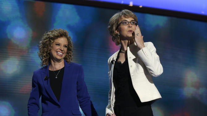 Former Rep. Gabrielle Giffords, right, blows a kiss after reciting the Pledge of Allegiance with Democratic National Committee Chairwoman Rep. Debbie Wasserman Schultz of Florida at the Democratic National Convention in Charlotte, N.C., on Thursday, Sept. 6, 2012. (AP Photo/Charles Dharapak)