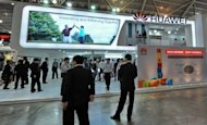 People visit the Huawei Technologies booth during a 2010 technology show. The leaders of a congressional probe into two Chinese telecom giants expressed fresh concerns about the firm's links to the Beijing government, as the companies, which include Huawei, defended their integrity