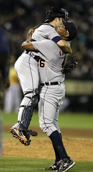 Detroit Tigers' Jose Valverde, right, lifts catcher Alex Avila as they celebrate on the mound after the Tigers clinched the AL Central Division title at the end of a baseball game against the Oakland Athletics, Friday, Sept. 16, 2011, in Oakland, Calif. (AP Photo/Ben Margot)