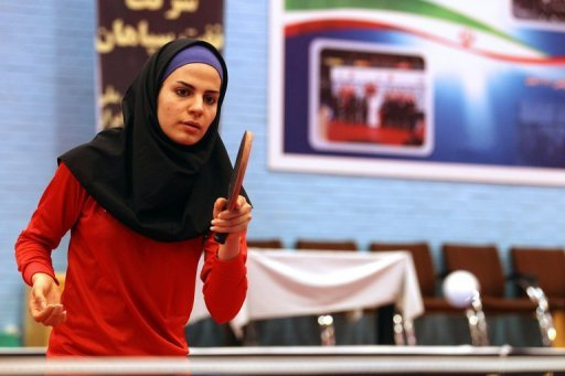 Neda Shahsavari, Iran&#39;s first woman to compete in table tennis at the Olympics, practises in Tehran on July 9.. Shahsavari, says she is &quot;thrilled&quot; to be going to the London Games, and dreams of winning a medal for the Islamic republic