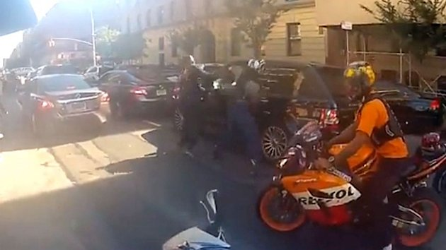 NYPD Cop Charged in Motorcycle Attack on SUV (ABC News)