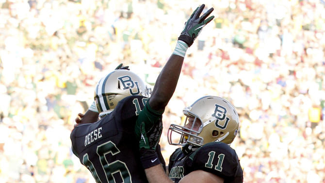Baylor wide receiver Tevin Reese (16) and quarterback Nick Florence (11) celebrate connecting for a touchdown pass during the first half of an NCAA college football game against Southern Methodist in Waco, Texas, Sunday, Sept. 2, 2012. (AP Photo/LM Otero)