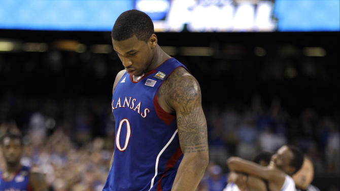 April 2 Kansas forward Thomas Robinson (0)  reacts after the NCAA Final Four tournament college basketball championship game Monday, April 2, 2012, in New Orleans.  Kentucky won 67-59. (AP Photo/Mark Humphrey)