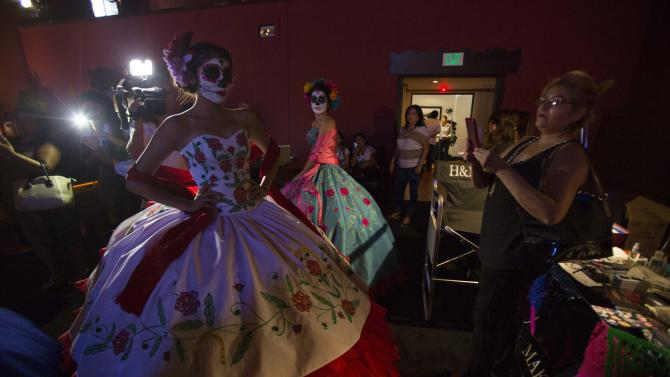 Models are pictured during a Quinceanera Magazine Catrina fashion show at a press reception ahead of the 15th annual Dia de los Muertos, or Day of the Dead, festival at Hollywood Forever Cemetery in Los Angeles