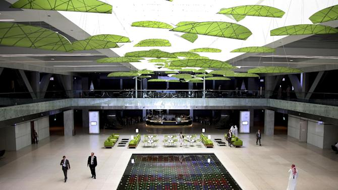 This Thursday, Sept. 20, 2012 photo shows the exhibition hall of the Qatar National Convention Center (QNCC) in Doha, Qatar. Green buildings would seem an oddity in this tiny Gulf nation which has plenty of oil and gas and, according to the International Energy Agency, the highest per capita emissions in the world, closely followed by Gulf neighbors Kuwait, Bahrain and the United Arab Emirates. But attitudes about energy use are changing across the Gulf. There is a growing recognition that the once seemingly limitless fossil fuels will someday run out and that these countries need to chart a more sustainable path. (AP Photo/Osama Faisal)