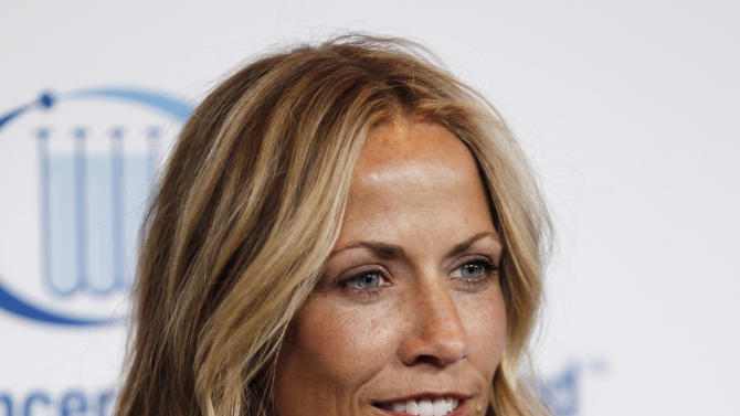 """FILE - This April 18, 2012 file photo shows musician Sheryl Crow at the Entertainment Industry Foundation's """"Unforgettable Evening"""" in Beverly Hills, Calif. Crow revealed to an audience that she has a benign brain tumor.  She's currently on a nationwide tour and battled breast cancer several years back. (AP Photo/Matt Sayles, file)"""