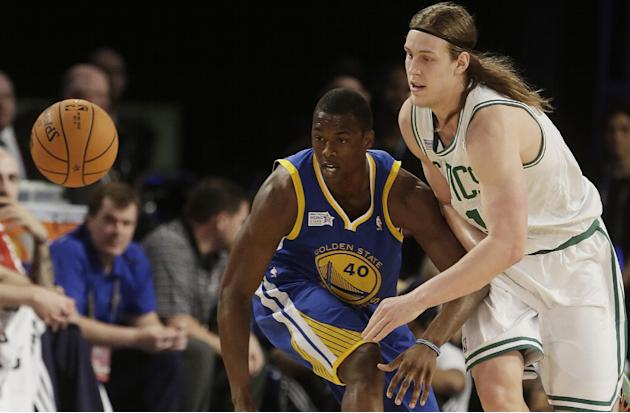 Team Webber's Kelly Olynyk of the Boston Celtics, right,  and Team Hill's Harrison Barnes of the Golden State Warriors vie for a loose ball during the Rising Star NBA All Star Challenge Basket