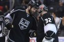 Los Angeles Kings left wing Dustin Penner (25) congratulates goalie Jonathan Quick (32) after Quick recorded a shutout against the San Jose Sharks in Game 5 of the Western Conference semifinals in the NHL hockey Stanley Cup playoffs, Thursday, May 23, 2013, in Los Angeles. The Kings won 3-0. (AP Photo/Mark J. Terrill)