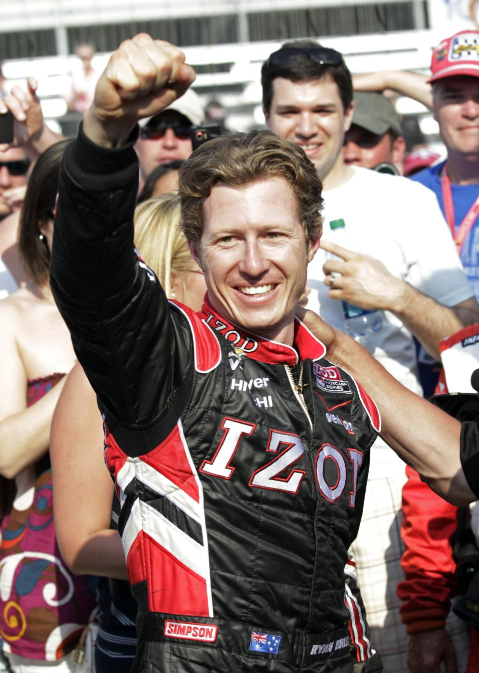 IndyCar driver Ryan Briscoe, of Australia, celebrates after winning the pole on the first day of qualifications for the Indianapolis 500 auto race at the Indianapolis Motor Speedway in Indianapolis, Saturday, May 19, 2012. (AP Photo/AJ Mast)
