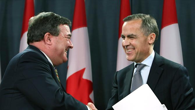 Canadian Finance Minister Jim Flaherty, left, shakes hands with Bank of Canada Governor Mark Carney, right, in Ottawa, Ontario, Monday Nov. 26, 2012.  Carney will become head of the Bank of England next summer. Flaherty called it a bittersweet moment as he announced Carney's new job as the first time a foreigner has been tabbed to run Britain's venerable national bank. (AP Photo/The Canadian Press, Fred Chartrand)