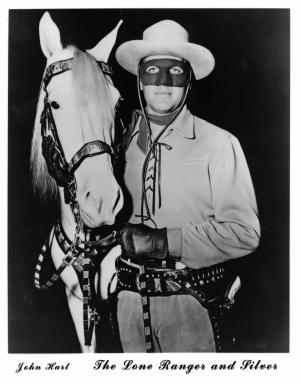 "This undated publicity still, circa early 1950s, provided by the Buffalo Bill Center of the West in Cody, Wyo., shows actor John Hart, who starred in the original ""The Lone Ranger"" television series, which ran from 1952-1954 and horse Silver. The Colt .45 single-action revolver he used is seen holstered. The museum has acquired the pistol made famous by the masked hero of television from more than 60 years ago. The revolver is now on display at the Buffalo Bill Center of the West, in Cody. Hart used several firearms over his acting career, but this gun is special. It features ivory grips and intricate engraving. (AP Photo/Buffalo Bill Center of the West)"