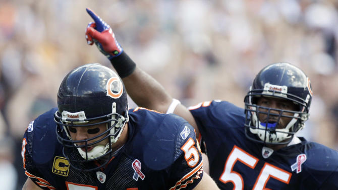 Chicago Bears linebacker Brian Urlacher (54) runs 12 yards for a touchdown after a fumble recovery against the Atlanta Falcons in the second half of an NFL football game in Chicago, Sunday, Sept. 11, 2011.  Bears' Lance Briggs, right, celebrates. (AP Photo/Nam Y. Huh)