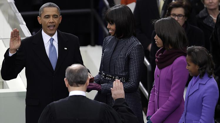 President Barack Obama takes the oath of office from Chief Justice John Roberts at the ceremonial swearing-in at the U.S. Capitol during the 57th Presidential Inauguration in Washington, Monday, Jan. 21, 2013 as first lady Michelle Obama and his daughters Malia and Sasha look on. (AP Photo/Evan Vucci)