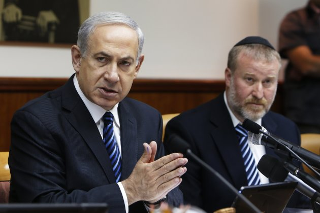 Israel's Prime Minister Netanyahu sits next to Cabinet Secretary Mandelblit as he speaks during the weekly cabinet meeting in Jerusalem