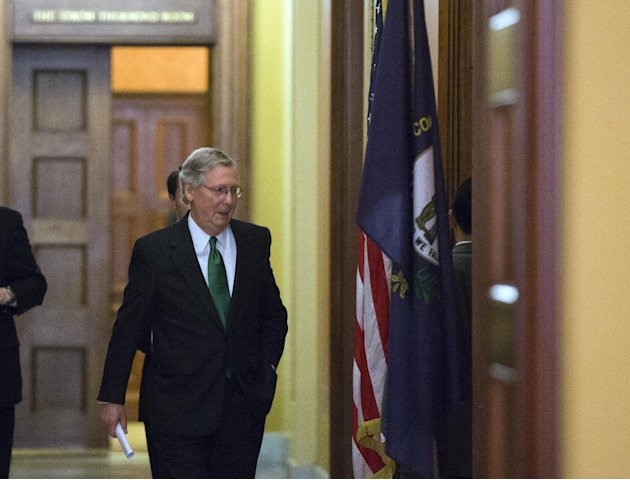 Senate Minority Leader Mitch McConnell, from Kentucky, departs the Strom Thurmond room after a Senate Republican caucus meeting about the fiscal cliff, on Capitol Hill, Monday, Dec. 31, 2012 in Washin