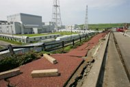 FILE - In this July 18, 2007 file photo, the pavement of an access road in the compound of Tokyo Electric Power Co.'s Kashiwazaki-Kariwa nuclear power plant is damaged following a powerful earthquake in Kashiwazaki, northeastern Japan. TEPCO requested on Friday, Sept. 27, 2013 that safety inspections be carried out that may allow it to restart two nuclear reactors, despite concerns over how it has handled the catastrophe at the Fukushima plant. All of Japan's nuclear plants are offline while regulators consider restarts under safety rules revised after the March 2011 earthquake and tsunami caused meltdowns at the Fukushima Dai-Ichi plant. (AP Photo/Koji Sasahara, File)
