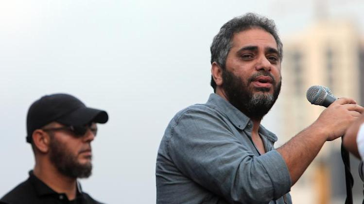 Lebanese singer Fadl Shaker (R) performs religious songs during a rally held in downtown Beirut by the Lebanese Sunni Muslim Salafist movement on September 21, 2012
