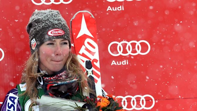 Mikaela Shiffrin stands on the podium after completing an alpine ski, women's World Cup giant slalom in Kuehtai, Austria, Sunday, Dec. 28, 2014. American teen Mikaela Shiffrin, who led after the opening run, came 0.18 behind in third. (AP Photo/Pier Marco Tacca)