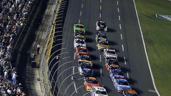 Drivers approach the start line to begin the first segment of the NASCAR Sprint Cup Series All-Star auto race at Charlotte Motor Speedway in Concord, N.C., Saturday, May 18, 2013. (AP Photo/Gerry Broome)