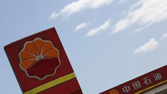 PetroChina's logo are seen at its gas station in Beijing
