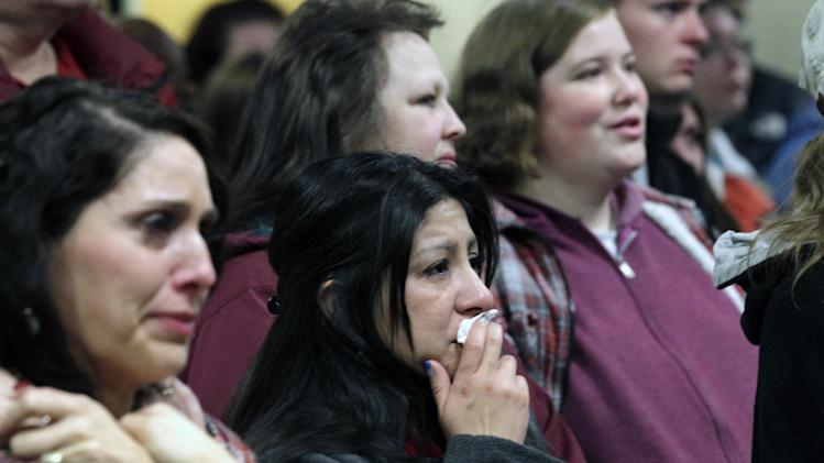 "Family members and friends of a 6-year-old Emilie Parker, killed in last week's Connecticut school shooting, look on during a memorial service Thursday, Dec. 20, 2012, at the Ben Lomond High School, in Ogden, Utah. Family members who brought blond-haired Emilie Parker back to Utah for her burial remembered the 6-year-old killed in the Connecticut school shooting as a ""picture of perfection"" at a memorial service Thursday in Ogden. (AP Photo/Rick Bowmer)"