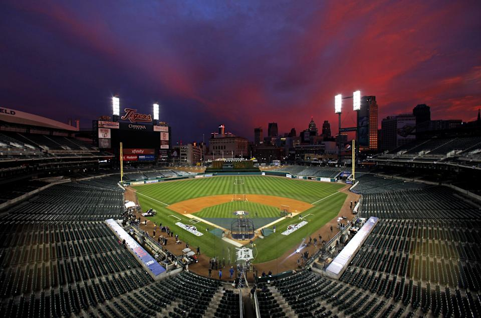 Colorful clouds are illuminated at sunset over Comerica Park in Detroit, Friday, Oct. 26, 2012. The Detroit Tigers host the San Francisco Giants in Game 3 of baseball's World Series  on Saturday. The Giants lead the best-of-seven series  2-0. (AP Photo/Paul Sancya)