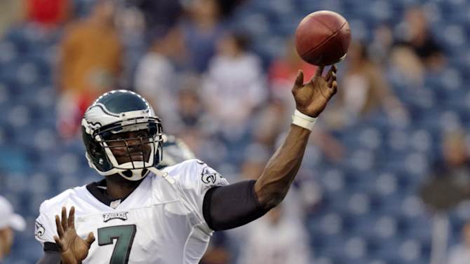 Philadelphia Eagles quarterback Michael Vick (7) throws during warm ups prior to facing the New England Patriots in an NFL preseason football game in Foxborough, Mass., Monday, Aug. 20, 2012.(AP Photo/Charles Krupa)