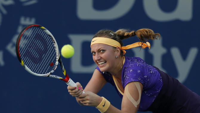 Petra Kvitova of the Czech Republic of returns to Ana Ivanovic of Serbia during the third day of Dubai Duty Free Tennis Championships in Dubai, United Arab Emirates, Wednesday, Feb. 20, 2013. (AP Photo/Regi Varghese)