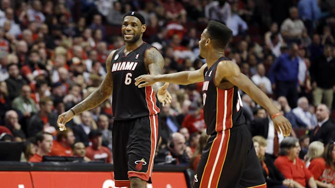 Miami Heat's LeBron James (6) and Norris Cole react during the second half of Game 4 of an NBA basketball playoffs Eastern Conference semifinal against the Chicago Bulls on Monday, May 13, 2013, in Chicago. (AP Photo/Nam Y. Huh)