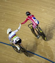Australia's Anna Meares (L) congratulates Great Britain's Victoria Pendleton as she celebrates after winning the Women's Team Sprint Final with her partner Jess Varnish at the UCI World Cup track cycling, an official test event for the London 2012 Olympic Games, at the Velodrome in the Olympic Park in London, in February