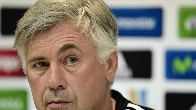 Real Madrid coach Carlo Ancelotti attends a press conference at the Valdebebas training ground in Madrid on August 18, 2014