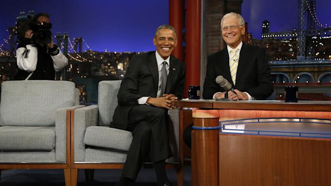 """U.S. President Obama sits during a taping of the """"Late Show with David Letterman"""" in New York"""