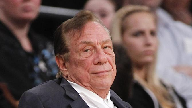 In this Dec. 19, 2011 file photo, Los Angeles Clippers owner Donald Sterling watches the Clippers play the Los Angeles Lakers during an NBA preseason basketball game in Los Angeles. The future of the Clippers is closer to decision as testimony resumes Monday, July 21, 2014,  in a probate trial over whether a deal negotiated by Donald Sterling's estranged wife to sell the team for $2 billion is authorized under a Sterling family trust