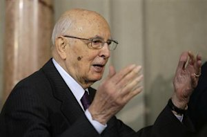 Italian President Giorgio Napolitano waves to reporters at the Quirinale palace