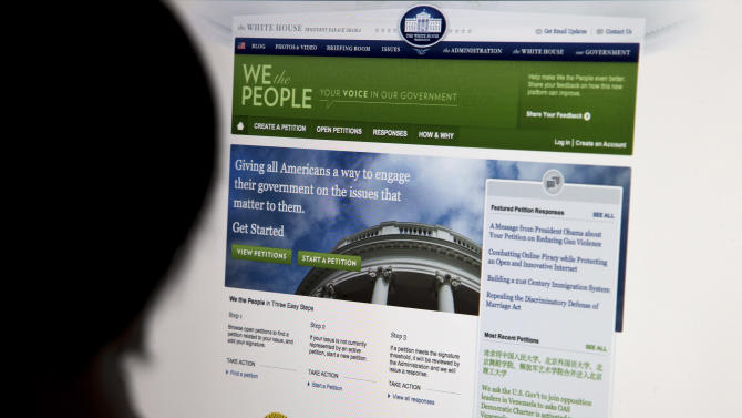 """The White House's online petition site called """"We the People""""  is displayed on a computer screen in Beijing Sunday, May 12, 2013. Through the Obama administration's """"We the People"""" site Chinese looking for justice have found a way to keep issues that our sometimes censored in their own country alive.  (AP Photo/Andy Wong)"""