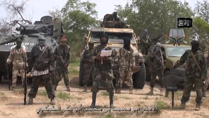 A screengrab taken on July 13, 2014 from a video released by the Nigerian Islamist extremist group Boko Haram and obtained by AFP shows the leader of the Nigerian Islamist extremist group Boko Haram, Abubakar Shekau (C)