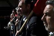 Greek workers march on February 20, 2013 during a 24-hour general strike in central Athens. About 15,000 striking workers took part in a Communist-organised demonstration in Athens and 20,000 more joined protests organised by other unions, according to police figures
