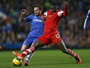 Chelsea's Mata challenges Southampton's Wanyama during their English Premier League soccer match against Southampton at Stamford Bridge in London