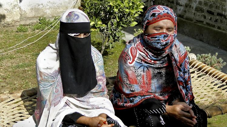 Badam Zari, right, addresses a news conference with her sister in Khar, capital of Pakistani tribal area of Bajur on Monday, April 1, 2013. A 40-year-old Pakistani housewife has made history by becoming the first woman to run for parliament from the country's northwest tribal region, a highly conservative area that is a haven for Islamist militants. (AP Photo/Anwarullah Khan)