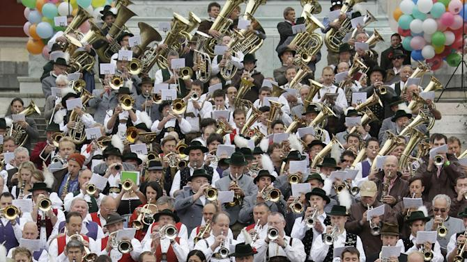 Musicians of the Oktoberfest orchestra play at the famous Oktoberfest beer festival concert in Munich, southern Germany, Sunday, Sept. 30, 2012. The world's largest beer festival, to be held from Sept. 22 to Oct. 7, 2012 will see some million visitors. (AP Photo/Matthias Schrader)