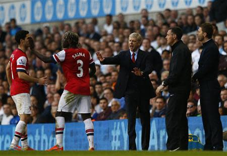 Arsenal's manager Wenger gestures after Sagna was hit by a ball thrown by Tottenham Hotspur's manager Sherwood during their English Premier League soccer match in London