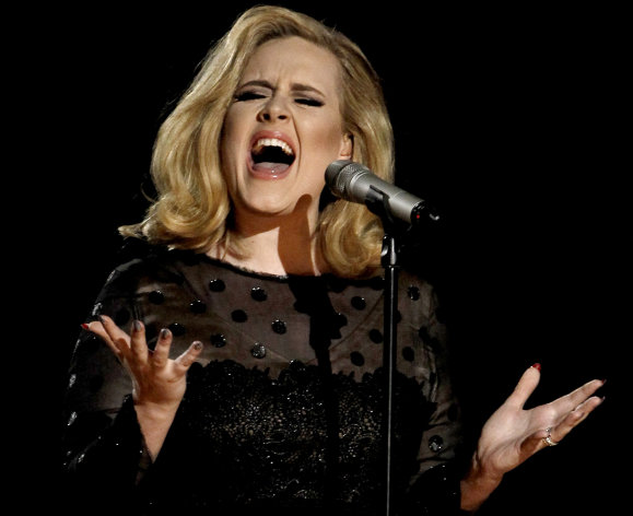 "FILE - In this Feb. 12, 2012 file photo, Adele performs during the 54th annual Grammy Awards in Los Angeles. The British singer's ""21"" was the highest-selling album in the U.S. for the second consecutive year, according to 2012 sales figures released by Nielsen SoundScan on Thursday, Jan. 3, 2013. That's a first in the SoundScan era. (AP Photo/Matt Sayles, File)"