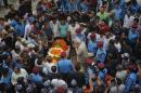 Nepalese Home Minister Bam Dev Gautam pays respect to Laxman Neupane, one among the police officers killed in Monday�s clashes in western Nepal, after his body was brought to Kathmandu, Nepal, Tuesday, Aug. 25, 2015. Ethnic protesters, demanding statehood, attacked police with spears and knives a day earlier in western Nepal. (AP Photo/Niranjan Shrestha)