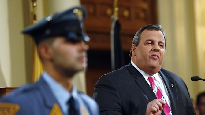 New Jersey Gov. Chris Christie gestures as he gives details on his 2014 state budget in Trenton, N.J., Tuesday, Feb. 26, 2013. Christie delivers his fourth budget proposal before a joint session of the Legislature at the State House during an election year as the state rebounds from the worst natural disaster in its history. (AP Photo/Rich Schultz)